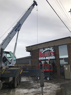 Crane Lifting Business Sign